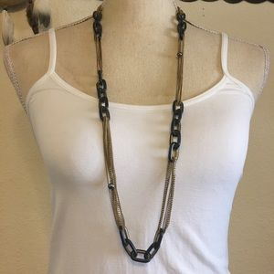Reaction multi strand gold chain link necklace